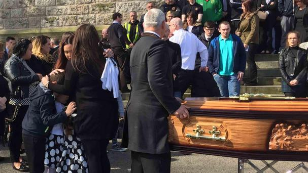 Family and friends attend the funeral of Belfast taxi driver Michael McGibbon