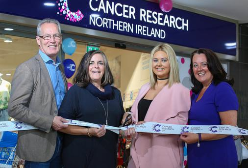 Cancer survivor Courtney Wedge with MLAs Paula Bradley and Gerry Kelly and Cancer Research UK area shop manager Kathryn Gallagher at the opening