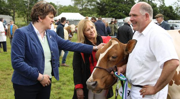 First Minister Arlene Foster and Agriculture Minister Michelle McIlveen chat with Iain McLean from Bushmills