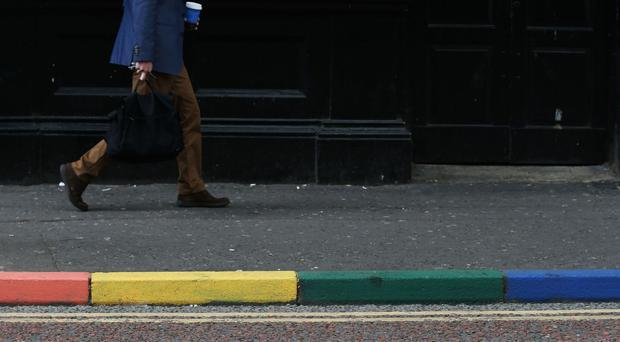 Kerb painted in rainbow colours outside a bar in Belfast during the annual Pride festival