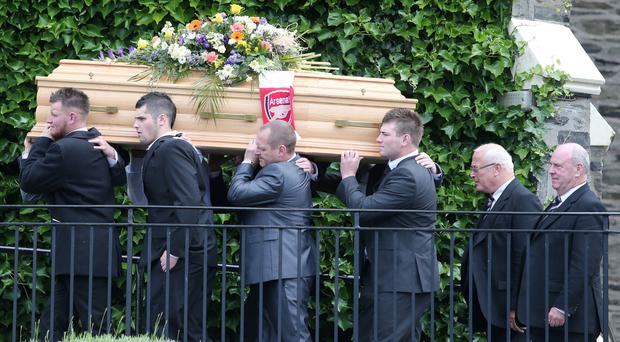 Jay Reardon's coffin is draped with an Arsenal scarf as it's carried into First Holywood Presbyterian Church