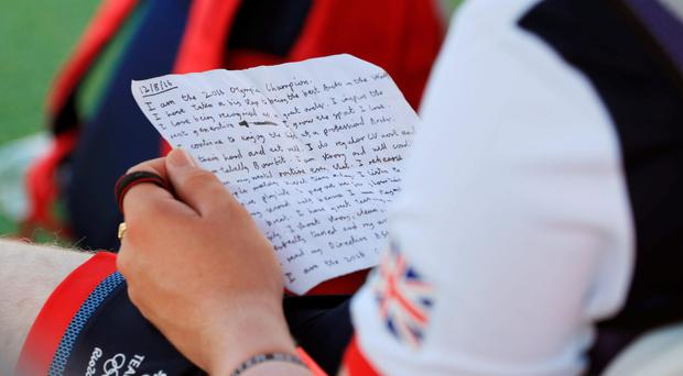 Patrick Huston reading the motivational letter he penned to himself
