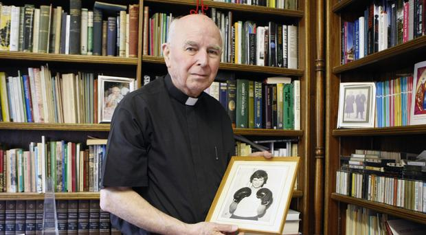 Edward Daly, with a portrait of Jackie Duddy, who was shot dead on Bloody Sunday