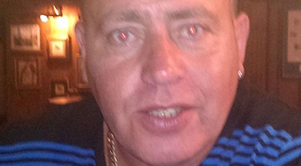 Senior paramilitary John Boreland was shot dead outside his north Belfast home