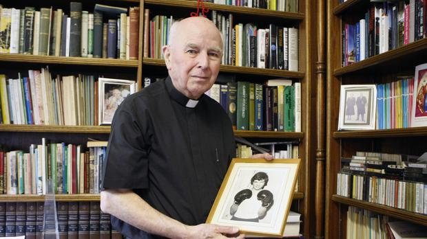 Edward Daly holding a portrait of Jackie Duddy, who was shot dead on Bloody Sunday