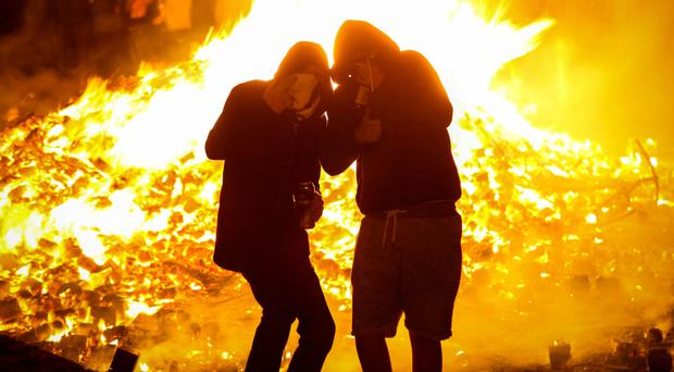 Revellers at an anti-internment bonfire in the New Lodge on Monday night