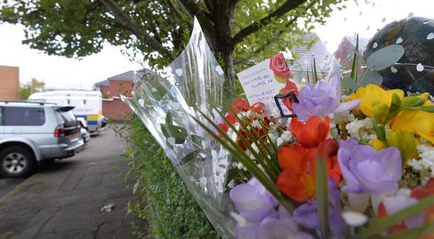 Flowers at the scene in Sunningdale Gardens, where top UDA figure John Boreland was shot dead on Sunday night