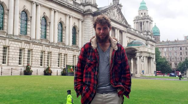 Alex at various Belfast sites after completing the 2,500-mile Irish leg of his journey around the entire coastline of Britain and Ireland