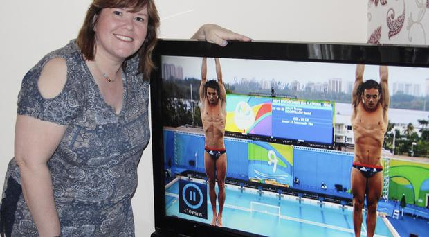 Debbie Donaghy, a relative of Olympic bronze winner Daniel Goodfellow, watches him on TV from her Coleraine home