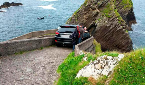 The car stuck on a walkway used by ferry passengers at Dunquin, Co Kerry