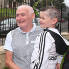 Paddy Copeland with his grandson Sean Og in front of the new railings and landscaped greenery