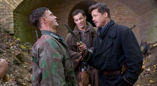 Brad Pitt holds a knife during a scene in Inglourious Basterds