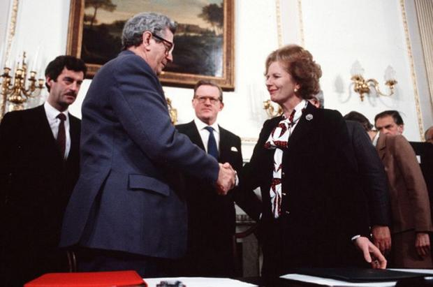 Margaret Thatcher and Garrett Fitzgerald shake hands on the Anglo Irish agreement, an accord which Sir David Goodall helped broker