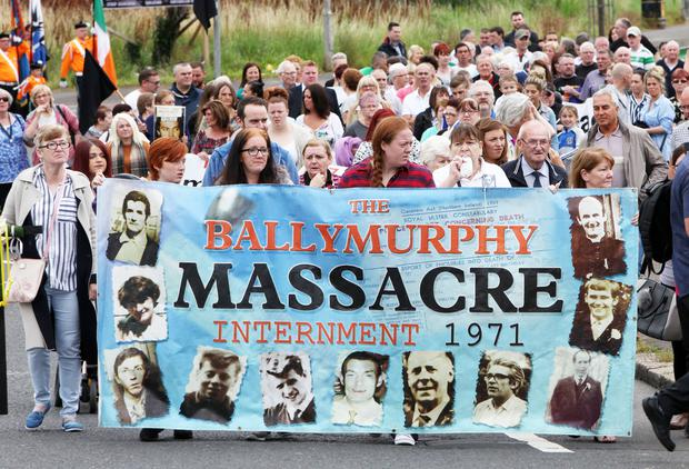 Supporters and families of people shot dead by the British Army in 1972 in the Ballymurphy area marching through west Belfast (File photo)