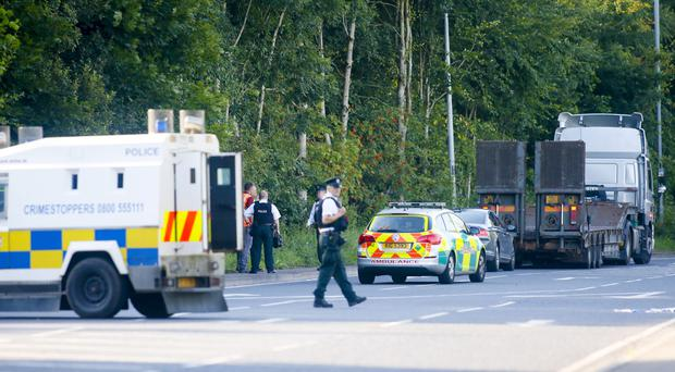 The scene of the accident, on the Brians Well Road, Dunmurry, in which a teenage boy collided with a lorry yesterday
