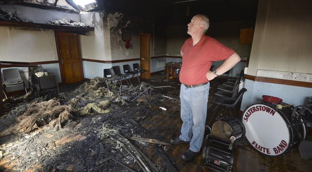 Deputy Master of Salterstown Lodge, Gordon Bryson, inspects the damage