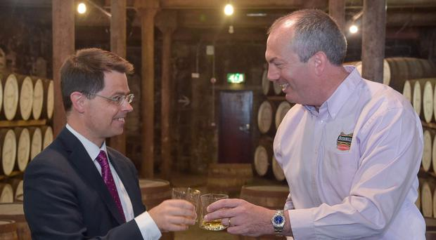 James Brokenshire at the Bushmills Distillery with Managing Director Colm Egan (Harrisons Photography/PA)