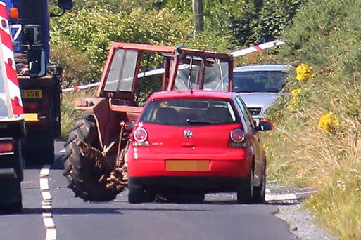 The scene of the crash at Hilltown Road, Co Down , yesterday, in which farmer Gerry Lively was killed