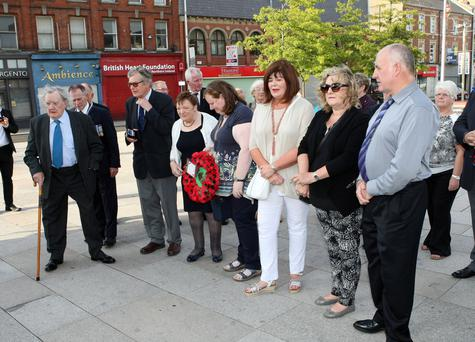 The two families stand side-by-side for a ceremony at the Royal British Legion, Portadown