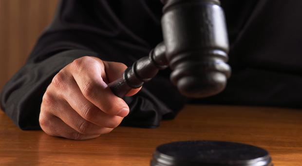 A 17-year-old boy's finger was cut off over a £700 drug debt, the High Court has heard