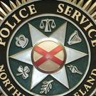 Police are trying to trace muggers who stole cash from two men at gunpoint in Carrickfergus