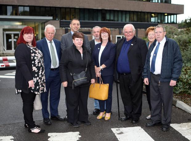 Families of the Ballymurphy massacre victims with Trevor Lunn MLA and solicitor Padraig O Muirigh before they met with Justice Minister Claire Sugden at Castle Buildings