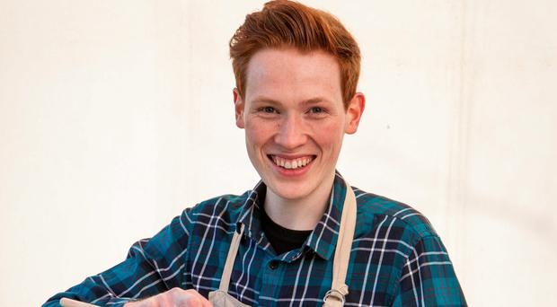Andrew Smyth cooking on the Great British Bake Off