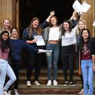 Pupils celebrate their GCSE results at King Edward VI High School for Girls in Birmingham
