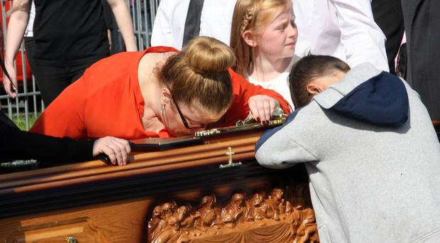 Relatives of Ballymurphy victim Joseph Murphy and his wife Mary say their last goodbyes as their coffins are carried into Corpus Christi church in Belfast