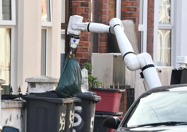 Police remove what was described as a viable device from a house in Belfast's Atlantic Avenue