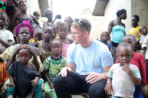 Pause for thought: Craig visiting a village where a number of people died from Ebola