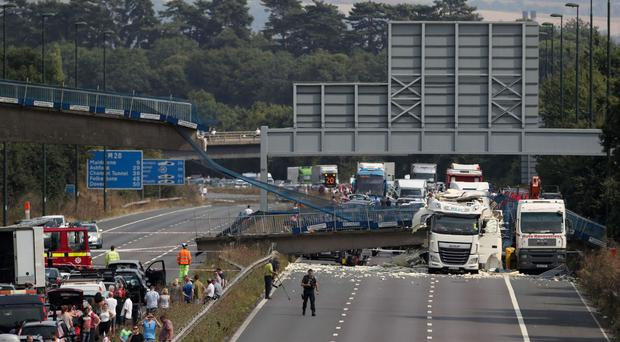 The scene on the M20 motorway after a lorry hit a motorway bridge, causing it to collapse