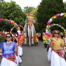 Families and revellers enjoy the 10th Belfast Mela yesterday as the city's Botanic Gardens were transformed into an eclectic global village showcasing culture and cuisine drawn from a wealth of nations, creating Northern Ireland's largest ever celebration of diversity