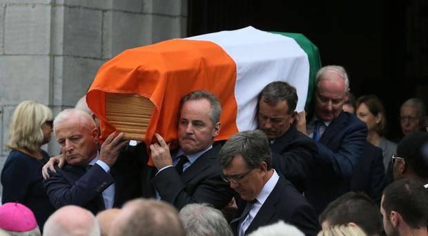 Peter Barry's coffin is carried from the church