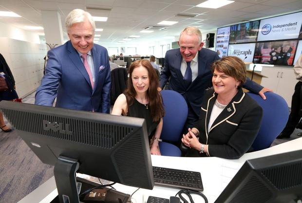 Belfast Telegraph Editor Gail Walker with Mrs Foster, Len O'Hagan and Leslie Buckley in the main editorial floor of the company's new headquarters at Clarendon Dock in Belfast following the official opening by the First Minister