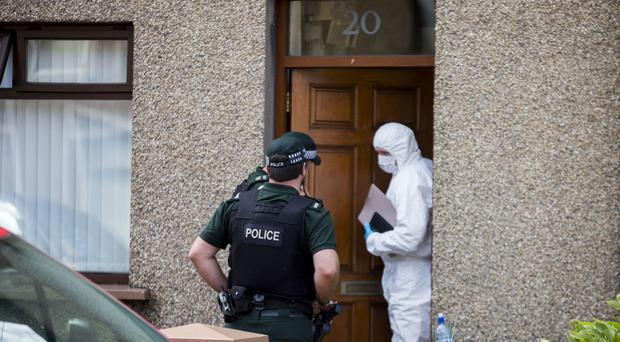 PSNI officers searching properties on Old Glenarm Road in Larne, Co Antrim, as Ciaran Maxwell is charged with terror offences.