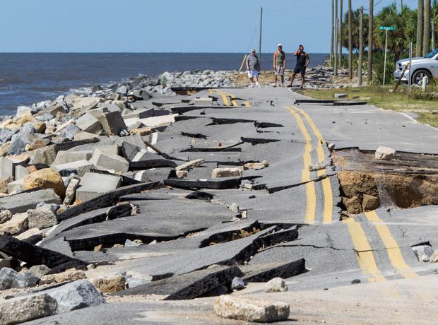 Residents look at Alligator Point Road that collapsed during the storm surge from Hurricane Hermine in Florida