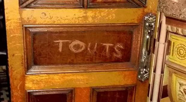 The defaced door in the newly refurbished Crown Bar in Belfast