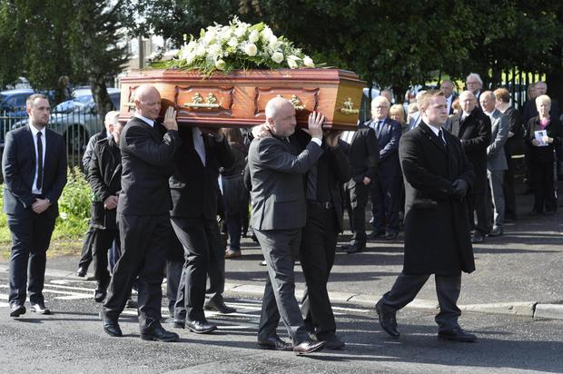 Family and friends at the funeral of journalist David Morgan