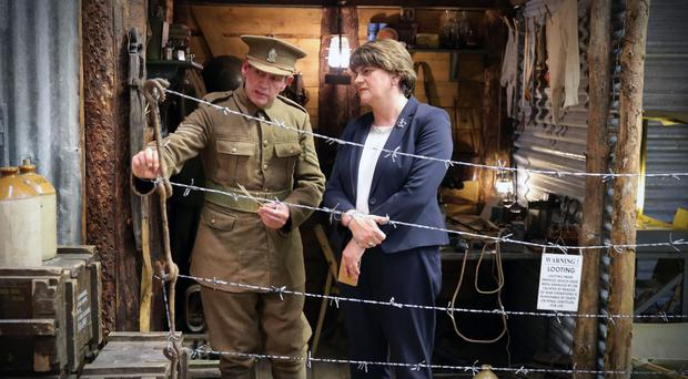 First Minister Arlene Foster is shown around the War Years Remembered Museum in Ballyclare by curator David McCallion