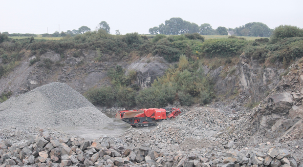 A rock crusher and screener on site at the quarry