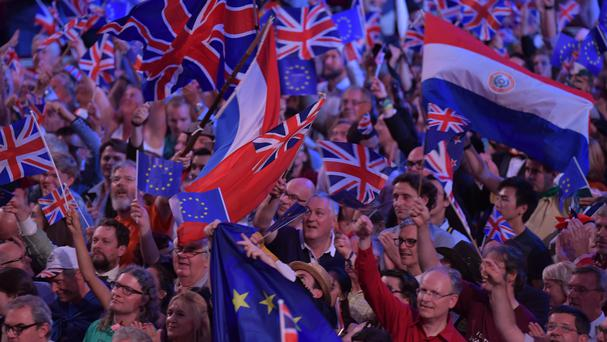 Concert-goers wave a variety flags including that of the EU at the Last Night of the Proms