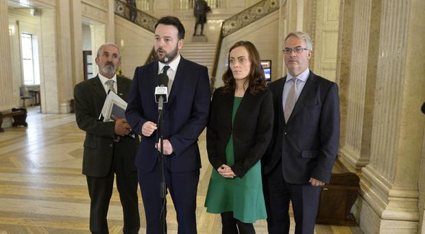 SDLP leader Colum Eastwood with colleagues Nichola Mallon and Alex Attwood before a meeting with Secretary of State James Brokenshire at Stormont