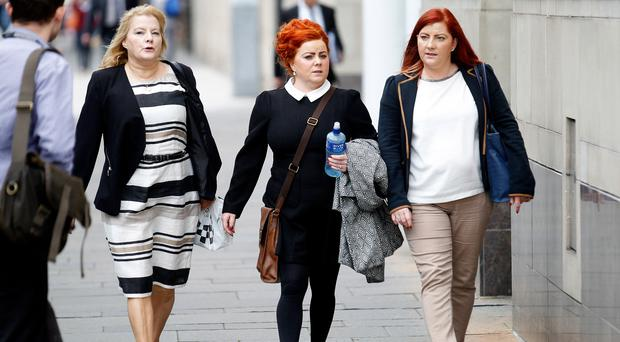 The inquest into the death of Charlie Patterson took place at Laganside courts yesterday with (from left) his daughter Anne Drain and his grand daughters Grainne and Bronagh Boyle in attendance