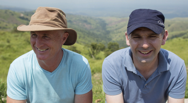 Charity workers David McAllister and Tim Magowan; with Consolate, a Tearfund staff member at a refugee camp.
