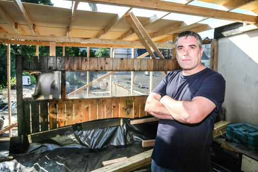Chester Bar general manager Gerard Quinn examines the damage