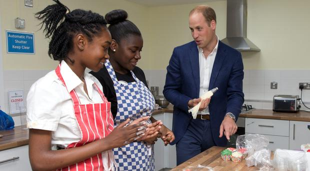 Prince William meets some young people during a visit to Caius House youth club in London
