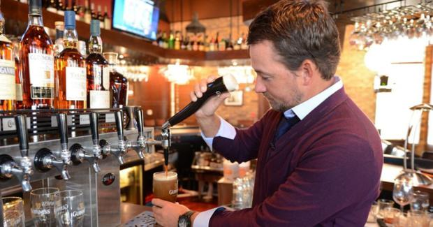 Graeme McDowell pulling a pint of Guinness in one of his Florida-based Nona Blue Taverns