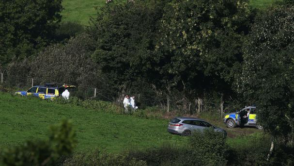 Police and forensics officers at farmland in Killen where new searches for Arlene Arkinson are under way