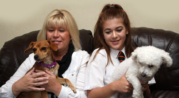 Audrey Lowndes and daughter Olivia with Melitsa (left), who's enjoying her new life with family pet Lola